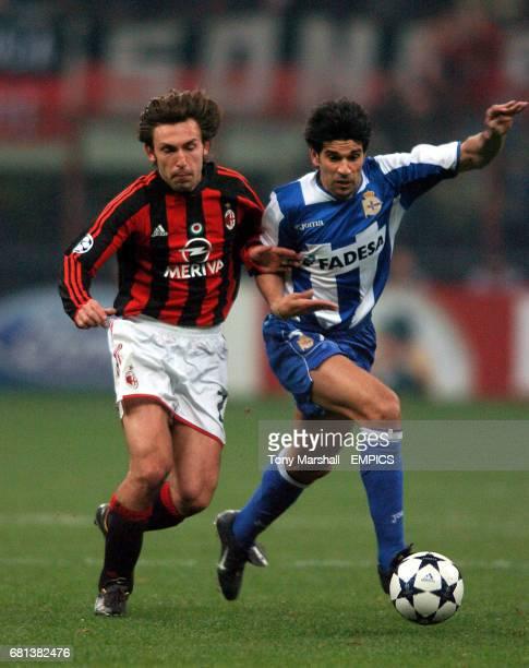 AC Milan's Anrea Pirlo grapples with Deportivo La Coruna's Juan Valeron