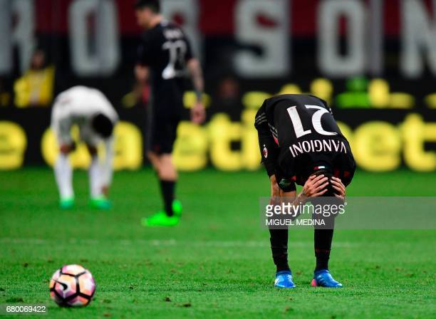 AC Milan's Argentinian defender Leonel Vangioni reacts during the Italian Serie A football match AC Milan vs AS Roma at the San Siro stadium in Milan...