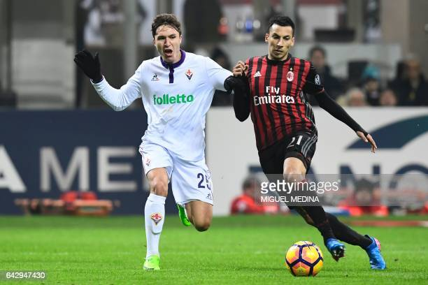 AC Milan's Argentinian defender Leonel Vangioni vies with Fiorentina's Italian forward Federico Chiesa during the Italian Serie A football match...