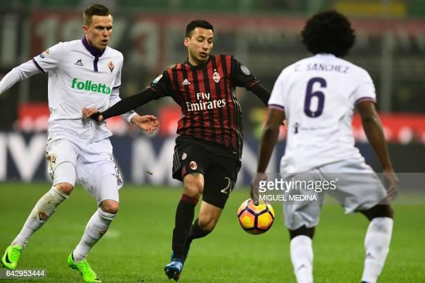 AC Milan's Argentinian defender Leonel Vangioni vies with Fiorentina's Slovenian forward Josip Ilicic and Fiorentina's Colombian midfielder Carlos...