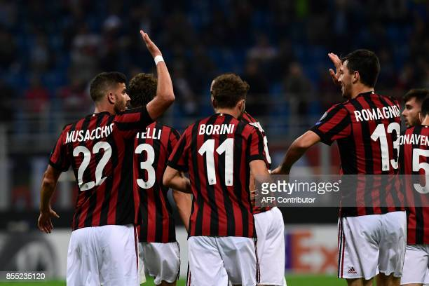 AC Milan's Argentinian defender Mateo Musacchio celebrates with teammates after scoring during the UEFA Europa League football match AC Milan vs HNK...