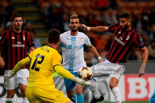 AC Milan's Argentinian defender Mateo Musacchio scores during the UEFA Europa League football match AC Milan vs HNK Rijeka at the San Siro stadium in...