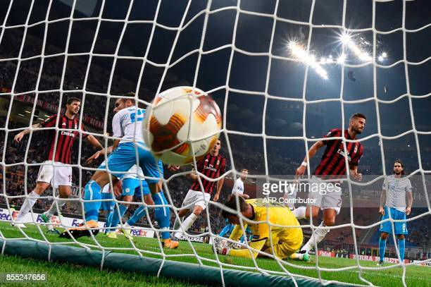 AC Milan's Argentinian defender Mateo Musacchio scores scores during the UEFA Europa League football match AC Milan vs HNK Rijeka at the San Siro...