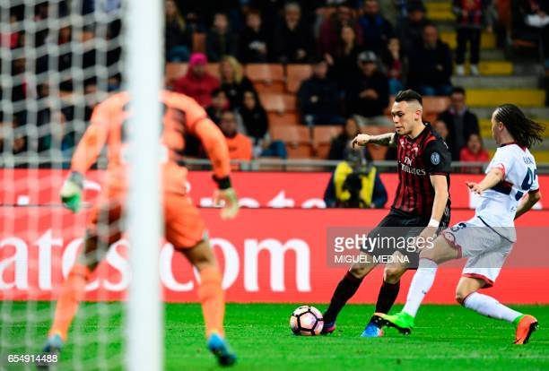 AC Milan's Argentinian forward Lucas Ocampos vies with Genoa's Uruguayan midfielder Diego Laxalt during the Italian Serie A football match AC Milan...