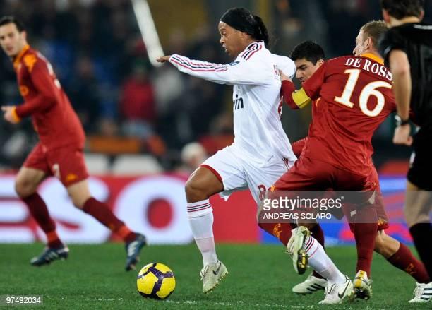 AC Milan's Brasilian forward Ronaldinho vies for the ball against AS Roma's midfielder Daniele De Rossi during their Italian Series A football match...