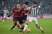 AC Milan's Brazilian defender Alex Dias da Costa fights for the ball with Juventus' Spanish forward Alvaro Morata on February 7 2015 during an...