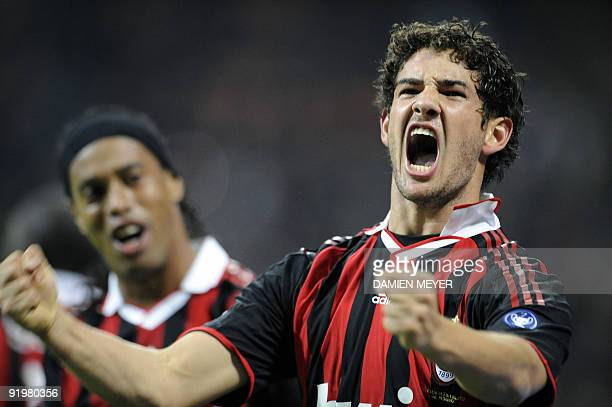 AC Milan's Brazilian forward Pato reacts next to teammate Ronaldinho after scoring against AS Roma during their Italian Serie A football match on...
