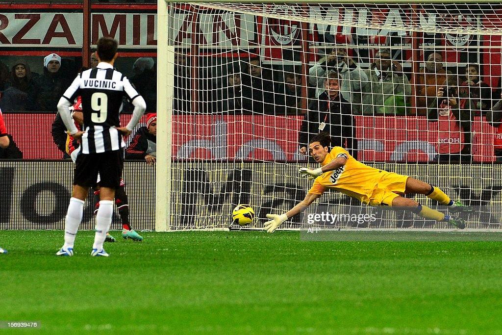 AC Milan's Brazilian forward Robinho kicks and scores a penalty during the Italian serie A football match between AC Milan and Juventus on November 25, 2012 at the San Siro stadium in Milan.