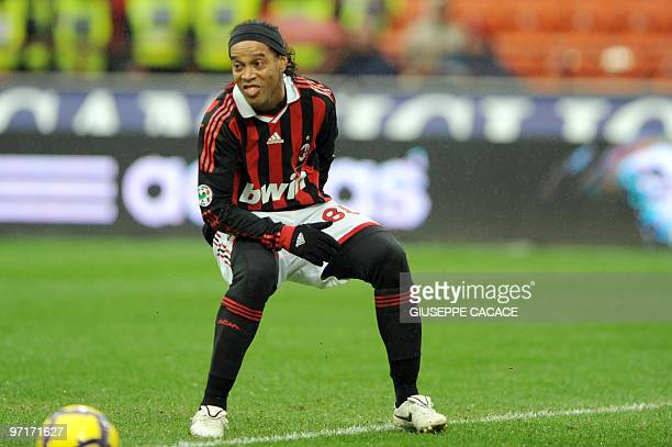 AC Milan's Brazilian forward Ronaldinho reacts after missing a penalty during his team's Serie A football match against Atalanta at the San Siro...