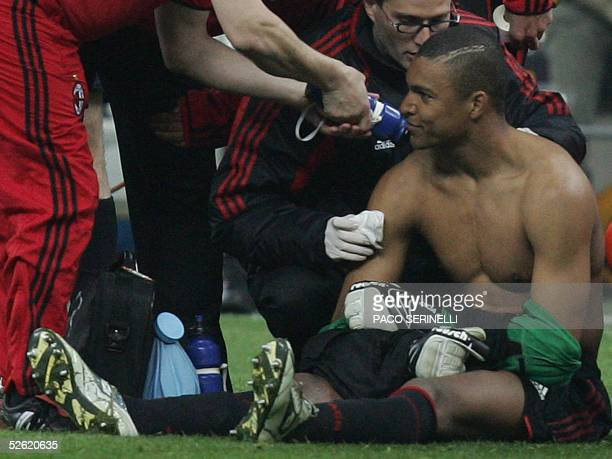 Milan's Brazilian goalkeeper Nelson Dida is treated by doctors after he was injured by fireworks during Inter Milan'sAC Milan's second leg Champions...