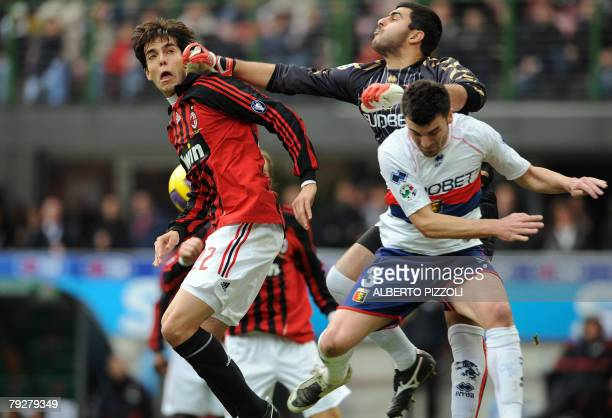 AC Milan's Brazilian midfielder Kaka fights for the ball with Genoa's Brasilian goalkeeper Rubens Fernando M Rubinho and Genoa's defender Cesare Bovo...