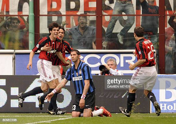AC Milan's Brazilian midfielder Kaka jubilates after scoring his first with AC Milan's forward Filippo Inzaghi and AC Milan's defender Daniele Bonera...