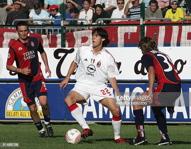 Milan's Brazilian midfielder Kaka vies with Cagliari's defenders Nelson Abijon and Roberto Maltagliati during their Serie A football match in...