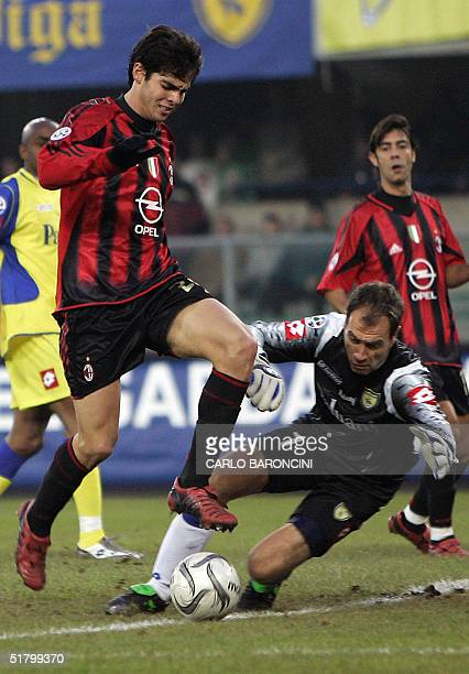 Milan's Brazilian midfielder Kaka vies with Chievo Verona's goalkeeper Luca Marchegiani during their Italian serie A football match at Bentegodi...