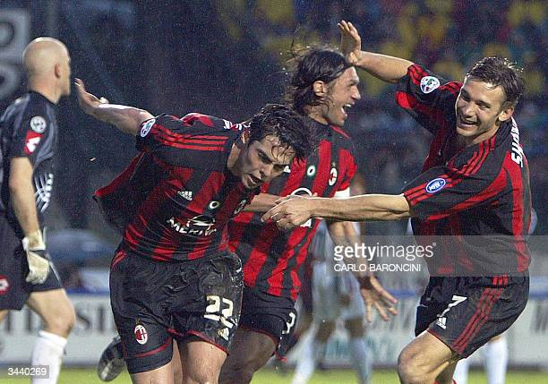 Milan's Brazilian midfielder Ricardo Kaka is congratulated by teammates Ukrainian striker Andryi Shevchenko and captain Paolo Maldini after scoring...