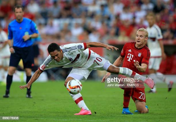 AC Milan's Carlos Bacca in action with Bayern Munich's Sebastian Rode