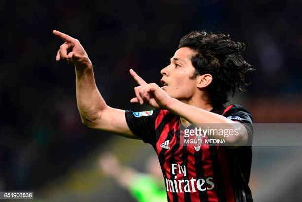 AC Milan's Chilian midfielder Mati Fernandez celebrates after scoring a goal during the Italian Serie A football match AC Milan versus Genoa on March...