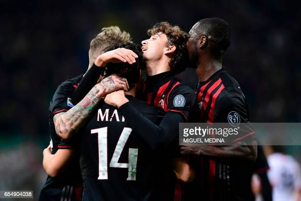 AC Milan's Chilian midfielder Mati Fernandez celebrates with teammates after scoring a goal during the Italian Serie A football match AC Milan versus...