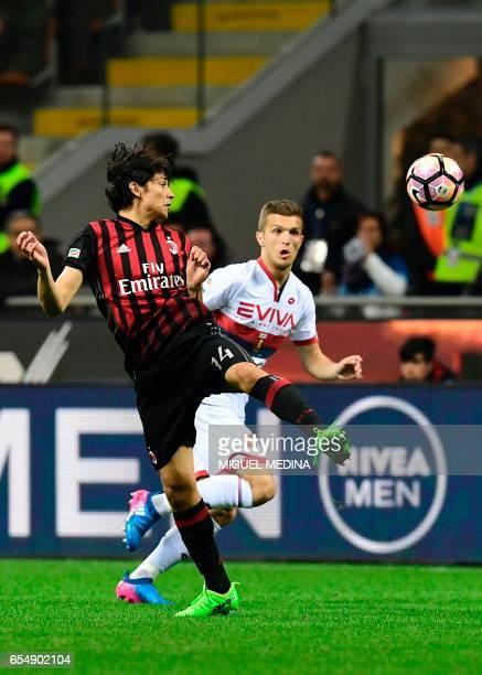 AC Milan's Chilian midfielder Mati Fernandez vies with Genoa's Serbian midfielder Darko Lazovic during the Italian Serie A football match AC Milan...