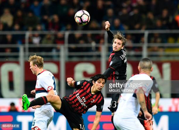 AC Milan's Chilian midfielder Matias Fernandez and AC Milan's Italian midfielder Manuel Locatelli jump for the ball during the Italian Serie A...