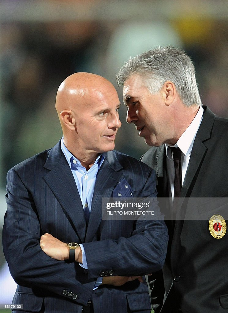 AC milan's coach Cerlo Ancellotti (R) talks to former colleague Arrigo Sacchi during a game for charity AC Milan vs Fiorentina on October 8, 2008 at Franchi stadium in Florence. The match is organized by former Milan and Fiorentina player Stefano Borgonovo, who suffers of Amyotrophic Lateral Sclerosis (ALS) to raise awareness and funds to search for a cure of the illness.