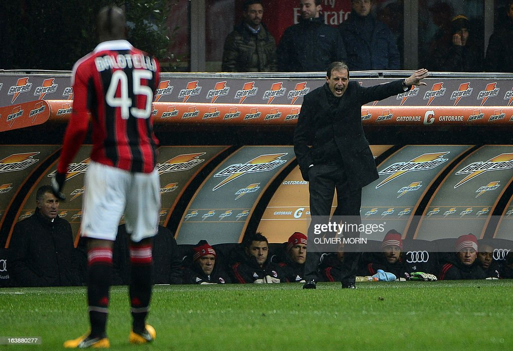 AC Milan's coach Massimiliano Allegri (R) gestures during the serie A football match between AC Milan and Palermo, on March 17, 2013 in Milan, at the San Siro stadium . AFP PHOTO / OLIVIER MORIN