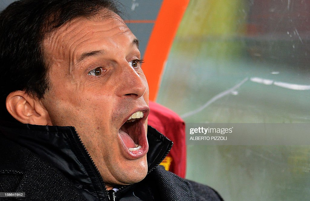 AC Milan's coach Massimiliano Allegri grimaces prior to the Italian Serie A football match between AS Roma and AC Milan on December 22, 2012, at the Olympic stadium in Rome.