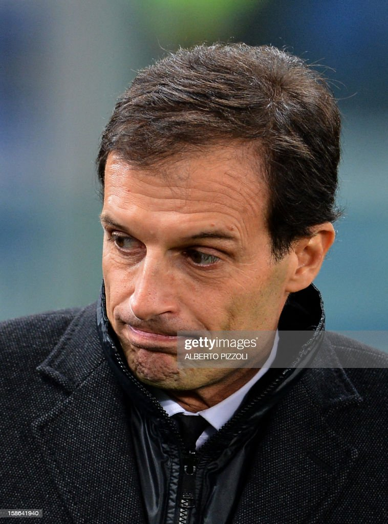 AC Milan's coach Massimiliano Allegri looks on prior to the Italian Serie A football match between AS Roma and AC Milan on December 22, 2012, at the Olympic stadium in Rome.
