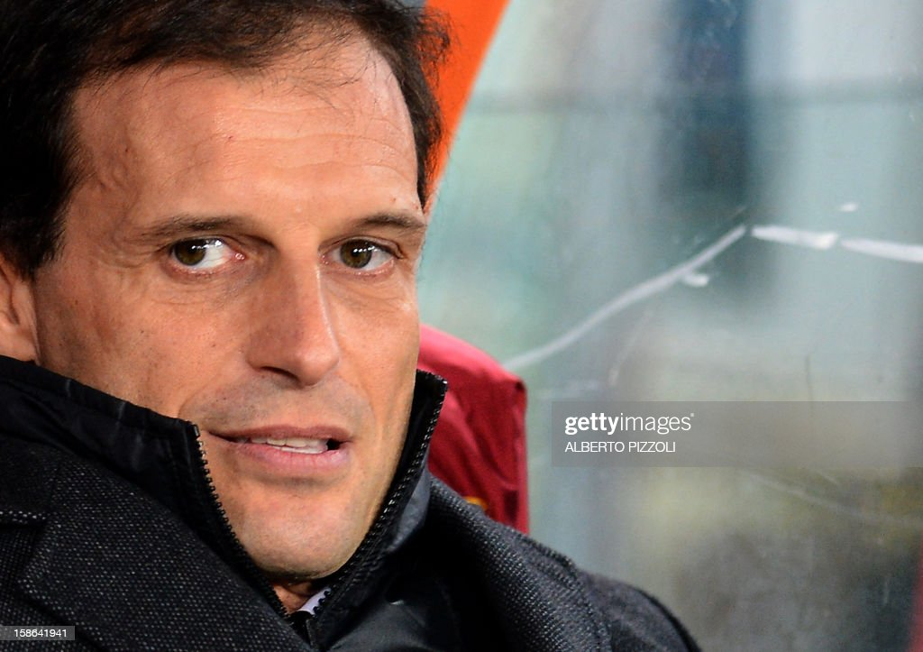 AC Milan's coach Massimiliano Allegri looks on prior to the Italian Serie A football match between AS Roma and AC Milan on December 22, 2012, at the Olympic stadium in Rome. AFP PHOTO / ALBERTO PIZZOLI