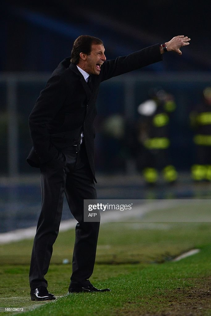 AC Milan's coach Massimiliano Allegri reacts during the Serie A football match between Chievo and AC Milan at the 'Bentegodi Stadium' in Verona on March 30, 2013.
