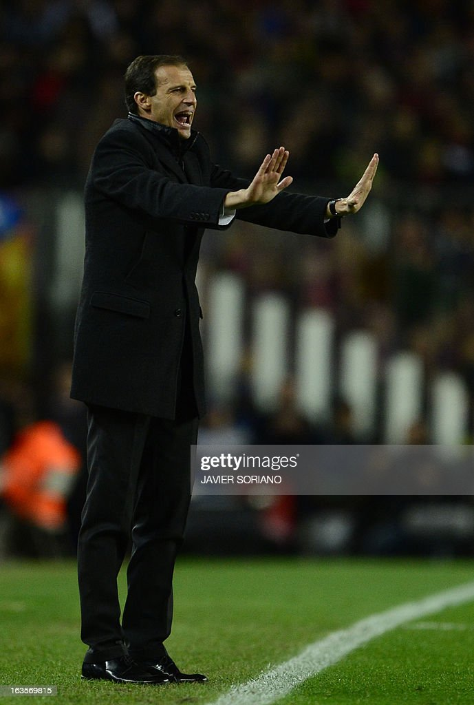 AC Milan's coach Massimiliano Allegri reacts during the UEFA Champions League round of 16 second leg football match FC Barcelona against AC Milan at Camp Nou stadium in Barcelona on March 12, 2013.