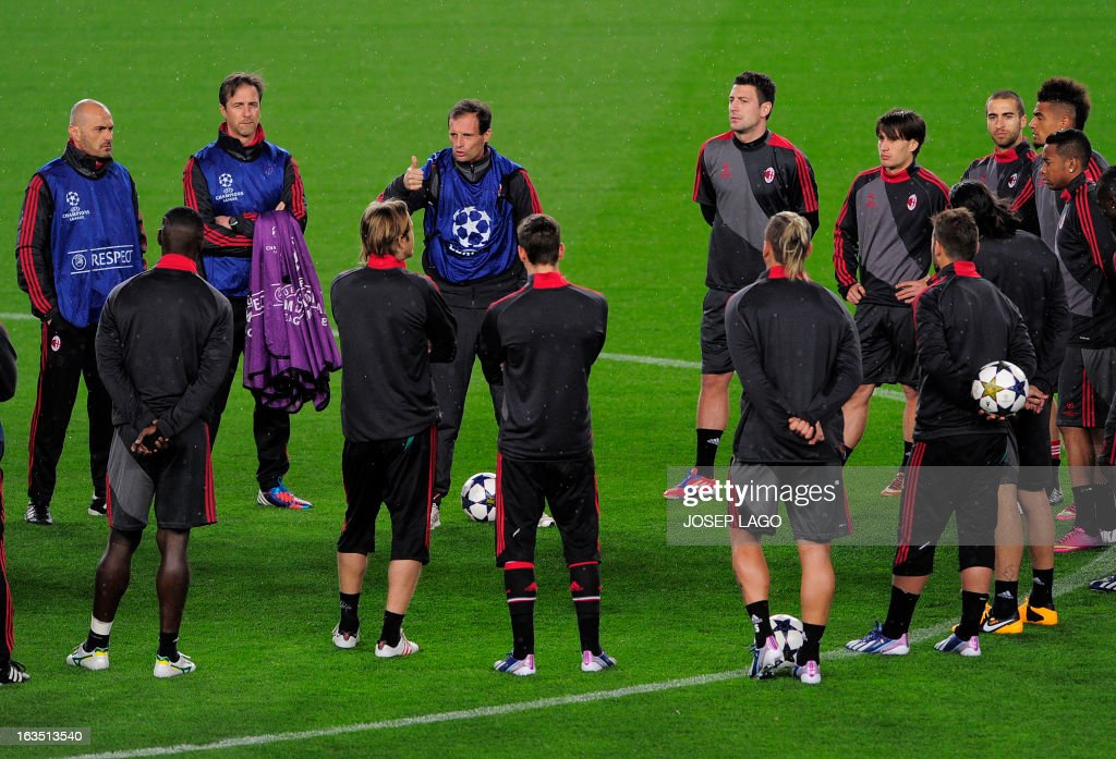 AC Milan's coach Massimiliano Allegri (3rd L) talks to his players during a training session at the Camp Nou stadium in Barcelona on March 11, 2013, on the eve of the UEFA Champions League football match FC Barcelona vs AC Milan.