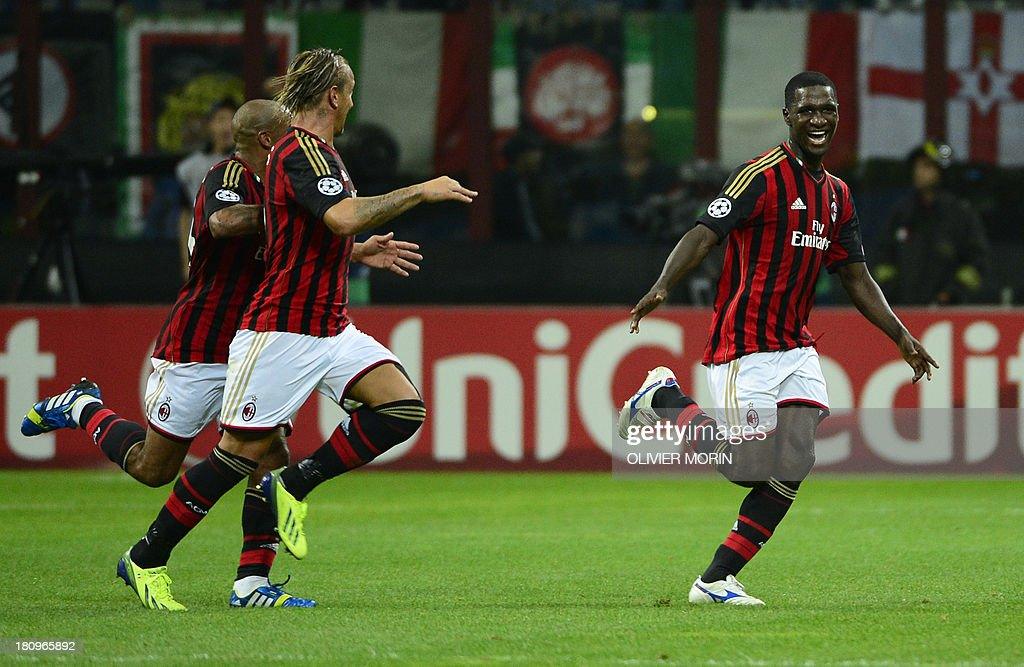 AC Milan's Colombian defender Cristian Zapata (R) celebrates after scoring during the Champions League football match between AC Milan and Celtic Glasgow, on September 18, 2013 in San Siro Stadium in Milan.