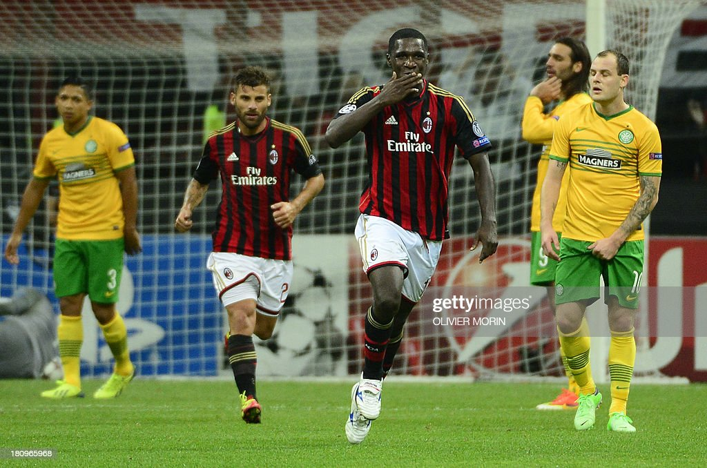 AC Milan's Colombian defender Cristian Zapata celebrates after scoring during the Champions League football match between AC Milan and Celtic Glasgow, on September 18, 2013 in San Siro Stadium in Milan.