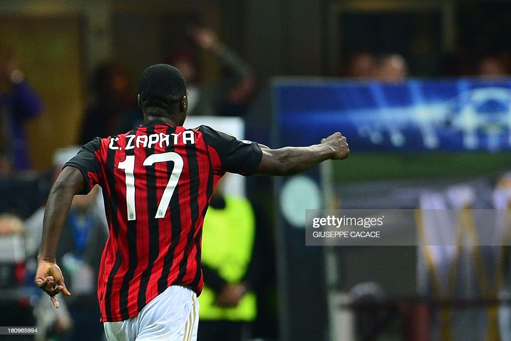 AC Milan's Colombian defender Cristian Zapata (C) celebrates after scoring during the Champions League football match between AC Milan and Celtic Glasgow, on September 18, 2013 in San Siro Stadium in Milan.
