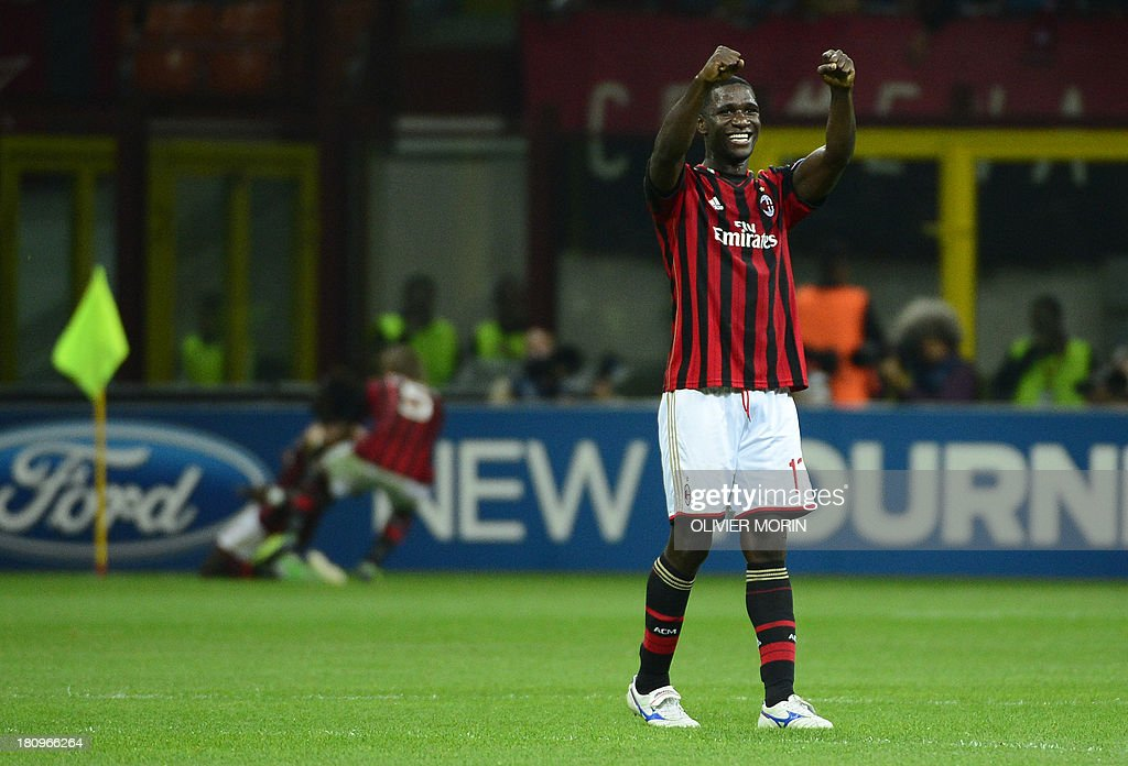 AC Milan's Colombian defender Cristian Zapata celebrates after scoring during the Champions League football match between AC Milan and Celtic Glasgow, on September 18, 2013 in San Siro Stadium in Milan. AFP PHOTO / OLIVIER MORIN