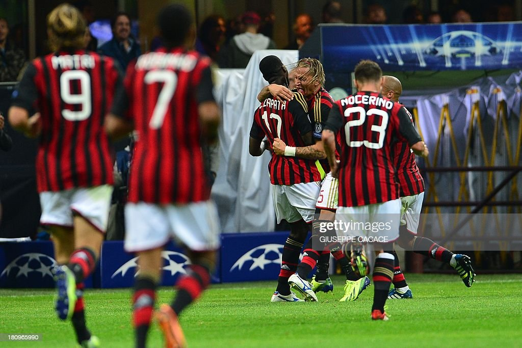 AC Milan's Colombian defender Cristian Zapata (C) celebrates with teammates after scoring during the Champions League football match between AC Milan and Celtic Glasgow, on September 18, 2013 in San Siro Stadium in Milan.