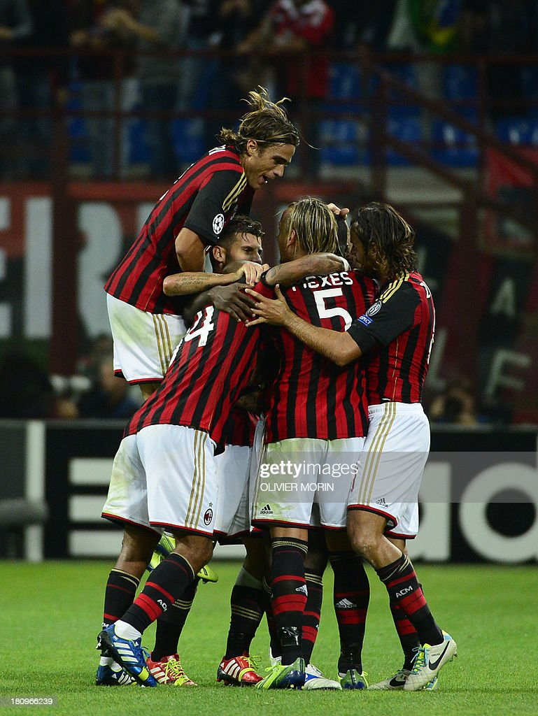 AC Milan's Colombian defender Cristian Zapata (not seen) celebrates with teammates after scoring during the Champions League football match between AC Milan and Celtic Glasgow, on September 18, 2013 in San Siro Stadium in Milan.