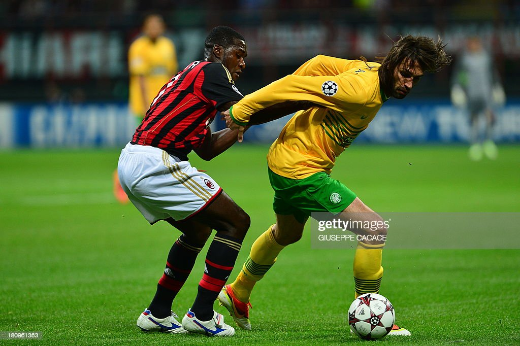 AC Milan's Colombian defender Cristian Zapata (L) fights for the ball with Celtic's forward of Greece Giorgios Samaras during the Champions League football match AC Milan vs Celtic Glagow on September 18, 2013 at San Siro Stadium in Milan. AFP PHOTO / GIUSEPPE CACACE