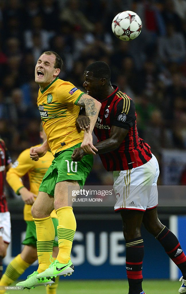 AC Milan's Colombian defender Cristian Zapata (R) fights for the ball with Celtic Glasgow' midfielder Anthony Stokes during the Champions League football match between AC Milan and Celtic Glasgow, on September 18, 2013 in San Siro Stadium in Milan.