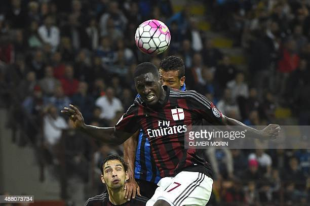 AC Milan's Colombian defender Cristian Zapata jumps to head the ball with Inter Milan's Colombian midfielder Fredy Guarin during the Serie A football...