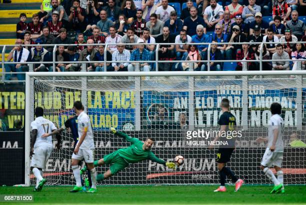 AC Milan's Colombian defender Cristian Zapata scores during the Italian Serie A football match Inter Milan vs AC Milan at 'San Siro' Stadium in Milan...