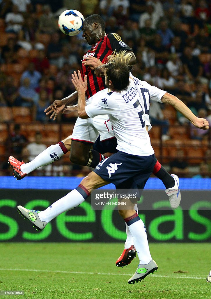 AC Milan's Colombian defender Cristian Zapata (L) vies for the ball with Cagliari's midfielder Daniele Dessena during the Serie A football match AC Milan vs Cagliari on September 1, 2013 at San Siro stadium in Milan .