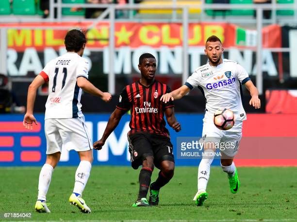 AC Milan's Colombian defender Cristian Zapata vies with Empoli's Moroccan midfielder Omar El Kaddouri during the Italian Serie A football match AC...