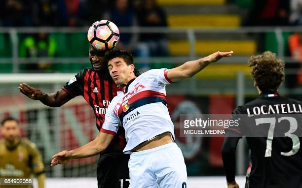 AC Milan's Colombian defender Cristian Zapata vies with Genoa's Argentinian forward Giovanni Simeone during the Italian Serie A football match AC...