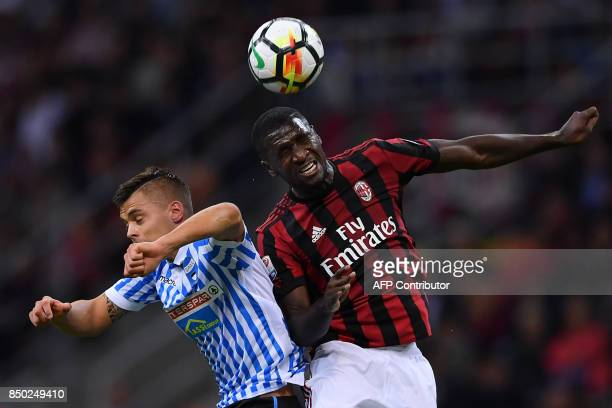 AC Milan's Colombian defender Cristian Zapata vies with Spal's Italian defender Francesco Vicari during the Italian Serie A football match AC Milan...