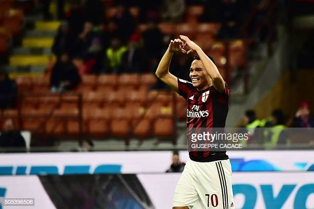 AC Milan's Colombian forward Carlos Bacca celebrates after scoring a goal during the Serie A football match between AC Milan and Fiorentina at the...
