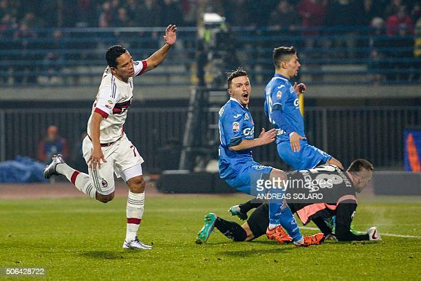 AC Milan's Colombian forward Carlos Bacca celebrates after scoring during the Italian Serie A football match Empoli vs AC Milan on January 23 2016 at...