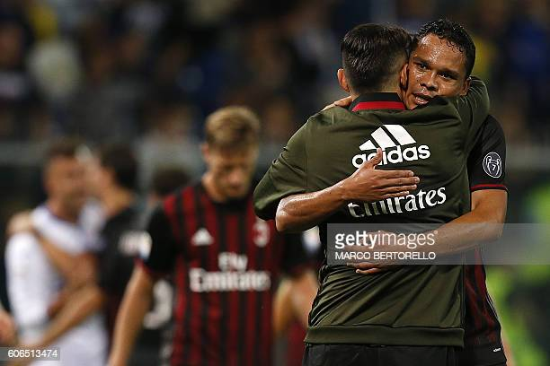 AC Milan's Colombian forward Carlos Bacca celebrates with AC Milan's forward Giacomo Lapadula at the end of the Italian Serie A football match...