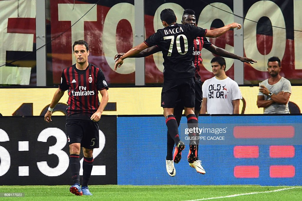 AC Milan's Colombian forward Carlos Bacca (L) celebrates with AC Milan's forward from France Mbaye Niang (R) after scoring a goal during the Italian Serie A football match between AC Milan and SS Lazio at the San Siro Stadium in Milan, on September 20, 2016. / AFP / GIUSEPPE